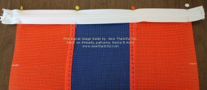 Determine preferred zipper orientation, pin zipper in place along edge of mesh as shown (right side of zipper facing right side of mesh/bag).