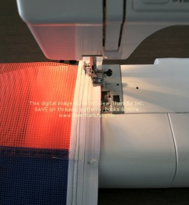 Align zipper tape with opposite edge of vinyl mesh, stitch as shown.