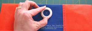 Once you determine where you want your grommet, mark the center of the grommet with a piece of marking chalk or other marker.