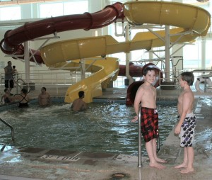 Jared & Jacob standing at the steps of the slide pool.