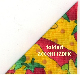 Accent fabric folded and pressed. Repeat to make triangles out of all four accent squares.