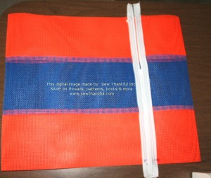 """Find the chalk marks made previously (5"""" from the mesh/zipper edge) and crease; flatten all the way down the bag and fold/crease at bottom as shown."""