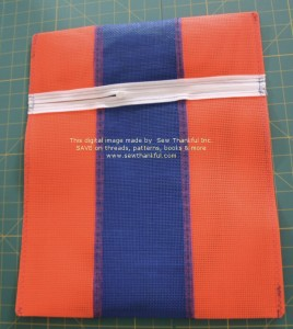 Carefully clip corners (do not clip any stitching). Trim off ends of zipper tape.